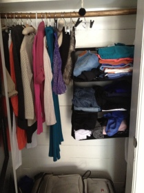 """My """"suitcase closet"""" - My aunt gave me this hanging drawer that easily fits into my suitcase for easy moving."""